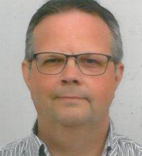 Portretfoto van John Dautzenberg